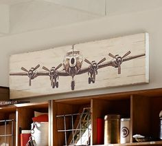 Small Planked Airplane Panels-This vintage style art is perfect for our casual space and the dimensions are great for above the sofa from @potterybarn