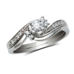 1/4 CT. T.W. Diamond Bridal Set in 10K White Gold - Zales -This is MY RING!! =) Only 1/2 CT total instead of 1/4 CT total. =) =)