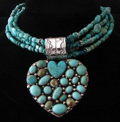 Necklace | Rocki Gorman (Navajo).  Turquoise and Sterling silver bead are combined with a heart designed by Kee Cook (Navajo) in Silver and turquoise.