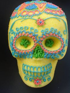 """Day of the Dead (Spanish: Día de los Muertos) is a Mexican holiday celebrated throughout Mexico and around the world in other cultures. A common symbol of the holiday is the skull (in Spanish calavera), which celebrants represent in masks, called calacas (colloquial term for """"skeleton""""), and foods such as sugar or chocolate skulls, which are inscribed with the name of the recipient on the forehead. Sugar skulls as gifts can be given to both the living and the dead."""