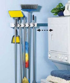 I need this!  Keep all of your brooms, mops, etc. organized and concealed with this Store 'N' Slide(TM) Organizer.