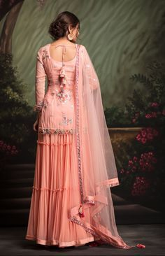 Peach short tunic with floral hand embroidered work clubbed with tier palazzo. Fabric: Viscous GGT Peach short tunic with floral hand embroidered work clubbed with tier palazzo. Sharara Designs, Kurti Neck Designs, Saree Blouse Designs, Dress Designs, Indian Wedding Outfits, Pakistani Outfits, Indian Outfits, Bridal Outfits, Indian Weddings