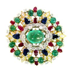 David Webb Floral Gemstone Brooch.Diamonds, cabachon emeralds, rubies and blue sapphires make this 18kt gold and platinum. 20th Century