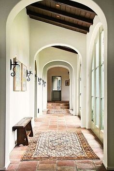 rugs on tile, exposed wood beams #rugs #tile #exposedbeams