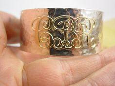 silver hammered  bangle or cuff bracelet with10 k gold initials. $200.00, via Etsy.