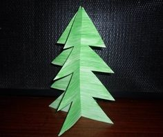 This three-dimensional tree is one of the simplest ways for your child to make a Christmas tree this year. If you're up for something a little more complicated though, you might want to try out  too.