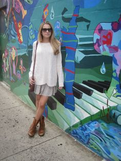 Wearing her Steve Madden Troopa boots in Cognac for Spring, layered with a  light sweater