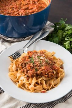 An image of a plate of tagliatelle bolognese with an authentic bolognese sauce recipe. An image of a plate of tagliatelle bolognese with an authentic bolognese sauce recipe. An image of a plate of tagliatelle bolognese with Best Bolognese Sauce, Vegan Bolognese, Sauce Recipes, Pasta Recipes, Dinner Recipes, Tagliatelle Recipes, Pasta Dishes, Food Dishes, Vegetable Bolognese