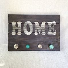 "Reclaimed pallet wood HOME wall art, corrugated tin lettering, cream and teal hanger knobs, 15x21"" by HadleyAndRuth on Etsy https://www.etsy.com/listing/243624999/reclaimed-pallet-wood-home-wall-art"