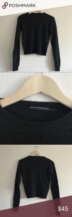 "Brandy Melville Dark Grey Sweater Soft blend wool crewneck sweater in dark grey. Brand new, never worn or washed. Fabrics: 70% wool, 30% acrylic Measurements: 22"" length, 18"" bust 