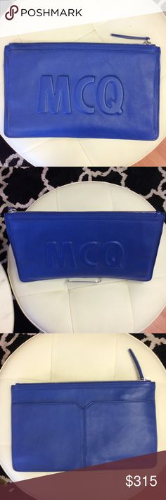 Alexander McQueen Blue Clutch Embossed logo lettering punctuates the front of this slim McQ - Alexander McQueen clutch. Slim back pocket. The top zip opens to a lined, single-pocket interior. Dust bag included. Black line through label required to prevent store returns.  Leather: Goatskin. Weight: 13oz / 0.37kg. Imported, China.  Measurements Height: 8in / 20.5cm Length: 12.5in / 32cm Alexander McQueen Accessories Tablet Cases