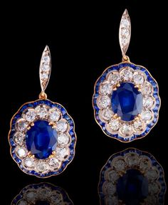 diamondsinthelibrary:   A pair of sapphire and diamond pendant earrings, each set with an oval-cut sapphire, within an old European-cut diam...