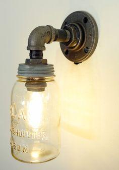 Found this on etsy.com.  Wonder how hard it would be to make? Mason Jar Light Fixture, Mason Jar Wall Sconce, Mason Jar Lighting, Mason Jar Lamp, Wall Sconces, Light Fixtures, Diy Mason Jar Lights, Pipe Lighting, Bathroom Lighting