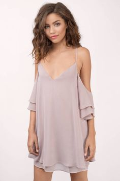 Let your heart flutter in the Borrow Love Shift Dress. A flowy, lace up dress featuring cold shoulder tiered sleeves, tiered hem, and soft v-neck with #shoptobi