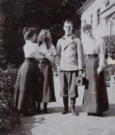 Grand Duchess Olga Alexandrovna Romanova of Russia and Grand Duke Mikhail Alexandrovich Romanov of Russia with their English cousins,Princesses Maud and Victoria of Wales at Bernstorff Palace in Denmark,about 1897. \