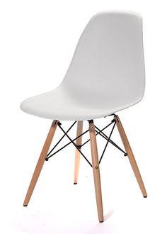 Silla Eames: Construida con patas de madera lustrada e hilos de acero que forman una autentica base Eiffel. La combinación aporta un efecto sobrio y exclusiva óptica de modernidad