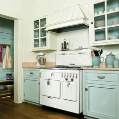 Aqua and white vintage inspired kitchen from This Old House.