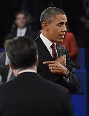 #133 Oct. 16- Obama Comes out More Aggressive in Second Debate;   Republican presidential nominee Mitt Romney, left, listens as President Barack Obama addresses members of the audience during the second presidential debate at Hofstra University, Tuesday, Oct. 16, 2012, in Hempstead, N.Y. (AP Photo/Pool-Michael Reynolds)