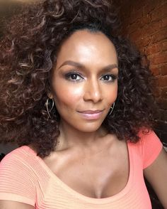 """Janet Mock: """"It's a wrap!"""" with @tgsfilm. Can't wait to share it with you all! Mug by @miyakemakeup. Curls by @hsbkhair_. #badass #livesoffeminists"""