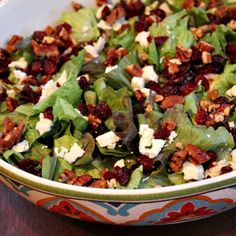 Salad With Vinagrette - combines onion, paprika, chopped pecans, red leaf lettuce feta cheese and cranberries! Very tasty!!