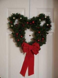 Mickey Wreath (how did I never think to make 1 of these?) Just get 2 small wreaths & wire them to a large wreath & decorate to your taste! So simple & cute!