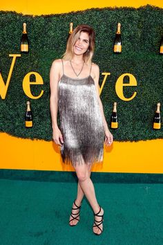 - Polo superstar Nacho Figueras's wife Deflina Blaquier was champagne personified in this shimmering Rachel Zoe mini.