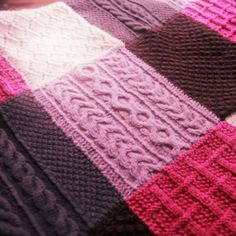 Knitted patchwork blanket with cable stitching made by www.ilovebloomers.com