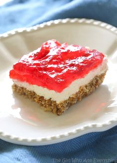Strawberry Pretzel Salad - a family favorite for bbqs and potlucks. A buttery pretzel crust topped with a cream cheese and jello layer. the-girl-who-ate-everything.com