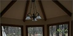 Ron & Judy's Kitchen - We continued the flooring into the dining room along with renovating the wood trim around the windows and on the ceiling.