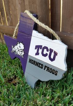 Rustic TCU Texas Shaped Flag with soft backing to protect your wall or door. This is a great way to show the Horned Frog Pride! Its customized to