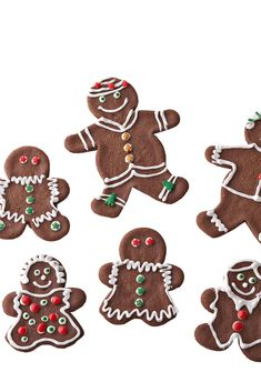 For a fresh twist on classic gingerbread cutouts, add chocolate to the mix. Dress them up with homemade powdered sugar icing and your favorite candies. #christmascookies #decoratedcookies #forkids #cuteholidaycookieideas #easy #bhg