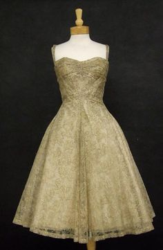 Vintageous, LLC - EXQUISITE Madame Gr??s Ecru Lace 1950's Cocktail Dress w/ Gold Embroidery, $1,400.00 (http://www.vintageous.com/exquisite-madame-gres-ecru-lace-1950s-cocktail-dress-w-gold-embroidery/)