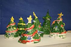 """Christmas trees made from """"pinch pots"""" of clay (?) and painted"""