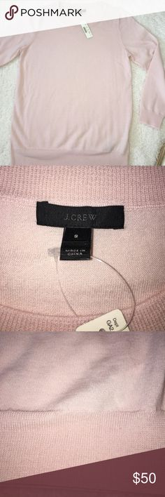 J. Crew New with tag 100% merino wool sweater New with tag Beautiful classic lightweight J crew merino wool sweater,  gorgeous soft lightl pink color, perfect for warmer Spring weather J. Crew Sweaters Crew & Scoop Necks