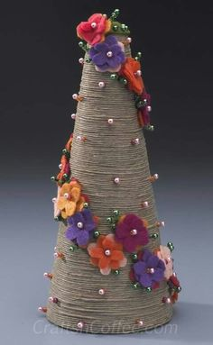 Patty Schaffer has done it again – she's sharing another must-have springtime topiary to DIY. Her Divine Twine Topiary pairs rustic twine with bold felt flowers and sparkling beads for a stunning c.DIY jute twine topiary tutorial by Patty Schaffe Christmas Tree Forest, Christmas Tree Crafts, Felt Christmas, Christmas Projects, Holiday Crafts, Christmas Decorations, Christmas Ornaments, Xmas Tree, Christmas Time
