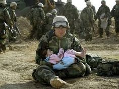 the man in war just found the child lying in the ground  and he pick him up the man is feeling bad because he has lost his life the guy is thinking who has done this and why and how and i going to cop with this