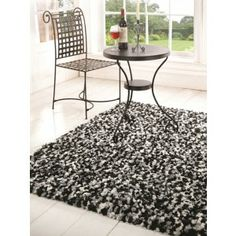 Black and Grey Shaggy Rugs. This rug is space dyed and gives a modern twist to plain shaggy rugs. http://www.therughouse.co.uk/shaggy-rugs