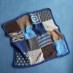 Baby boy crochet blanket. I made most of the squares out of the free sampler afghan pattern from Red Heart by Marrianne Forrestal.