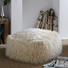 I want this Faux Mongolian Lamb Pouf from west elm. Pretty sure hubby won't want it.