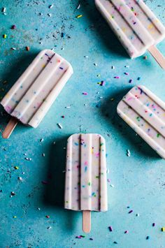 Who doesn't love a good frozen treat?! These funfetti popsicles are a SIMPLE and refreshing summer dessert recipe that you can probably make with ingredients you already have on hand. Fun breakfast recipe too -- I'm serious! They would even make a fun, healthy birthday dessert for a kid or an adult. You'll need Greek yogurt, almond milk, vanilla, and rainbow sprinkles -- that's it!