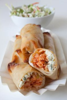 103 calories each!! What, what, what??? Buffalo Chicken Rolls, crisp outside, moist shredded buffalo-sauced chicken, with creamy, cool, and pungent blue cheese, and a few strands of refreshing slaw. via can you stay for dinner #heaven