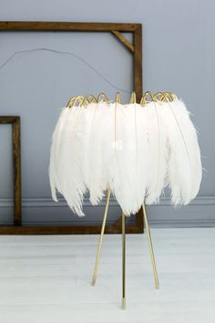 Add a touch of lux with Mineheart white Feather Table Lamp.This decadent table lamp is both elegant and lux with a hint of gold. Feather Lamp, Feather Boas, White Table Lamp, Table Lamps, White Feathers, Home Living, Living Room, My New Room, Home Interior