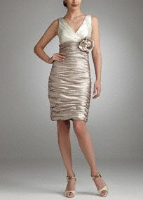 Subtly seductive, this all over ruched dress is the perfect pick for any party this season! Contrasting ivory bodice and champagne skirt give this style a chic look. All over ruching creates a flattering ruching hourglass shape. 3D floral detail adorns the waist for added femininity. Fully lined. Back zip. Imported polyester. Dry clean only. Available in Ivory/Champagne.Tight decorative gathers which create flattering pleats in the fabric.