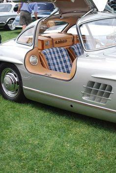 Vintage silver Mercedes. Classic car with classic plaid upholstery. Doesn't get much cuter than this.