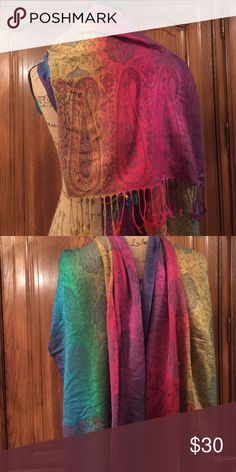 """Boutique Purchase Rainbow Paisley Print Scarf Never worn the colors are iridescent in the light it is a cotton blend item. It measures 5' 10"""" without the fringe and the fringe is 3"""" long. And it measures 30"""" wide Accessories Scarves & Wraps"""