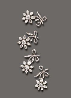 A RARE ANTIQUE SET OF FOUR DIAMOND FLOWER BROOCHES   Each old European and pear-shaped diamond flowerhead, extending an old mine and old European-cut diamond stem, mounted in silver, (two diamonds deficient), mid 18th century. Purportedly once belonged to the Russian Imperial family.