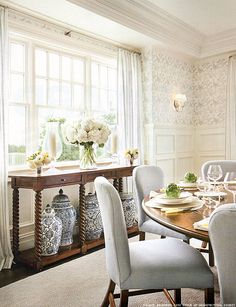 Inspiration photo Option 1...blue and white dining room, more traditional/chinoiserie ..stencil above chair rail, white below, switch out existing armchairs for upholstered host chairs in pale blue. Reupholster seats of armless chairs