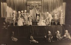 Stage performance: A small group of people can be seen watching Princesses Margaret and Elizabeth on stage during Aladdin in 1943