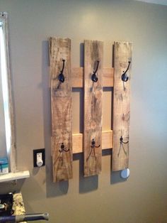 Just add a few hooks to any pallet and hang.  This is great for a hallway or next to a door for children to hang their backpacks.