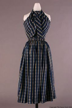 Dress,1950 Designer Balenciaga, Cristobal, 1895-1972 Navy blue and gold plaid dress with full short skirt and halter neckline. Synthetic fabric. Self-fabric belt. Bodice lined with navy blue crepe; has boning. Unlined skirt has navy blue petticoat, possibly of silk organza. Front